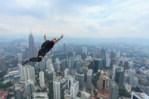 Kuala Lumpur, Malaysia-September 30, 2011: A BASE jumpers in jumps off from Kuala Lumpur Tower. KL Tower BASE Jump is an annually event and participants from experienced BASE jumpers from all around the world.